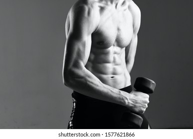 Sexy man with inflated torso biceps muscle bodybuilder