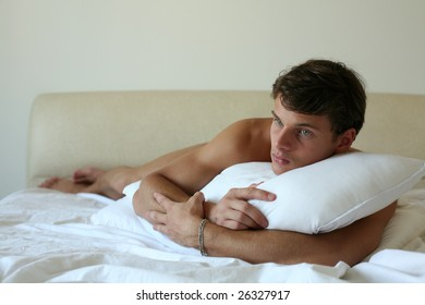 Sexy man lying on a bed