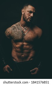 Sexy man with muscular body and bare torso
