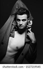 Sexy man nude torso fashionable suit model dark background