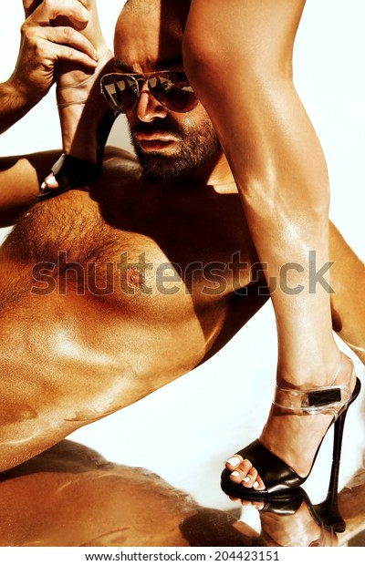 Sexy man on naked woman