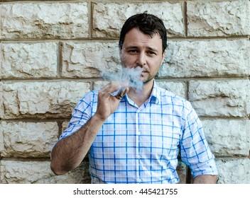 Sexy man smoking cigar