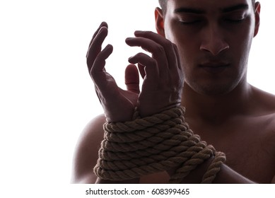 Sexy man with tied hands