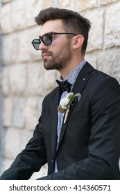 Sexy man in tuxedo posing