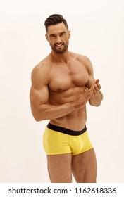 Sexy man in underwear isolated on white background