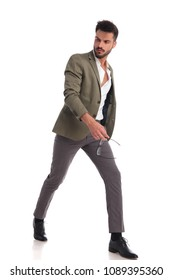 51d1dd825c6b sexy man walking to side on white background with undone shirt land green  suit looks to