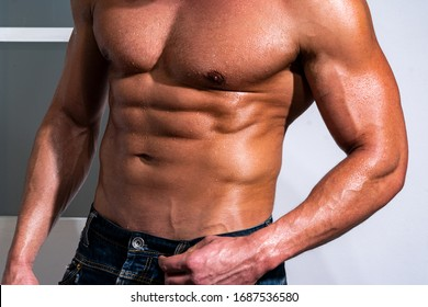 Sexy mans body. Muscular man with abs. Close up on perfect abs. Strong bodybuilder with six pack