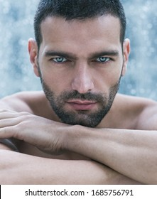 Sexy masculine portrait of topless handsome male model with beautiful eyes looking into camera.