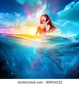 sexy mermaid emerges out from sea at sunset. concept art
