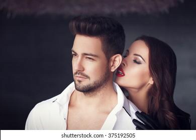 Sexy milf woman whispering macho man indoor