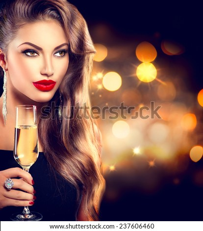 b71d3c1f5d89 Sexy model girl with glass of champagne at party, drinking champagne over  holiday glowing background
