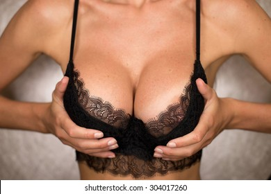 sexy model holding breasts