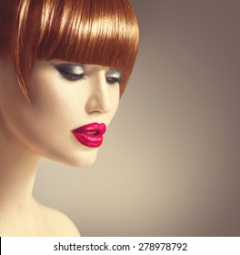 Sexy model woman face. Beauty girl portrait, beautiful lady with red hair, fringe hairstyle. Perfect makeup, red lips. Fashion glamour haircut, long fringe. Beautiful Smooth brown hair. Make-up