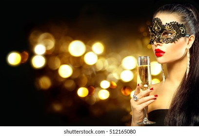 Sexy model woman with glass of champagne wearing venetian masquerade mask at party, drinking champagne over holiday glowing background. Christmas and New Year celebration, Dark blinking background