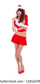 Sexy Mrs. Santa eating lollypop, studio shot
