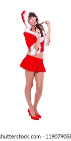 Sexy Mrs. Santa with lollipop over white background