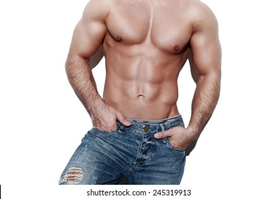 Sexy muscular man body, posing at white wall
