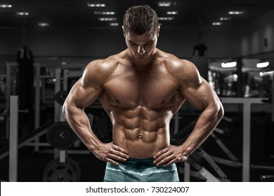 a62d7cc87 Sexy muscular man in gym, shaped abdominal. Strong male naked torso abs,  working
