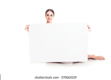 Sexy naked girl with a poster. Clean skin. Hair removed. Isolate. For advertising and presentation.