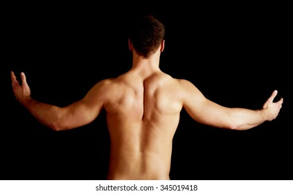 Sexy naked muscular man showing his muscular back.