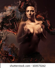 sexy nude woman in dark and burning paper