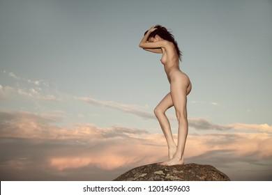 Sexy nude woman posing on the beach