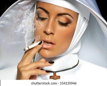 Sexy nun. Halloween. Nun smoking