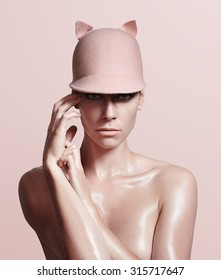 sexy oily woman wearing a pig hat