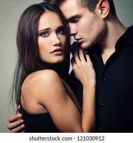 Sexy passion couple, beautiful young man and woman closeup, studio shot