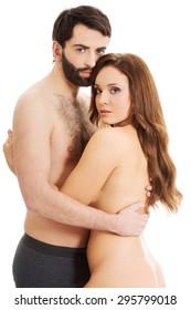 Sexy passionate heterosexual couple embracing.