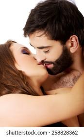 Sexy passionate heterosexual couple kissing.