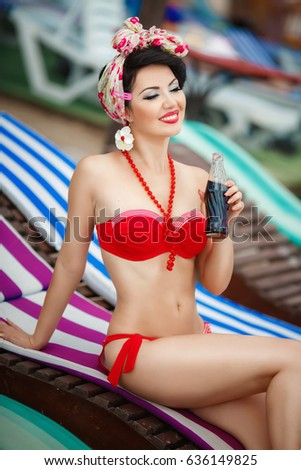 ef6c2bd0bc363 Sexy pin up woman in red bikini retro style relaxing at beach at Varadero.  Happy