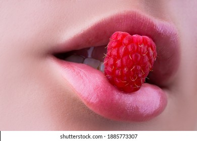 Sexy pink lips with raspberry. Womans enjoying. Female eating raspberry. Sensual enjoyment. Closeup female mouth tasting raspberry. Sweet enjoyment. Sexy and erotic concept