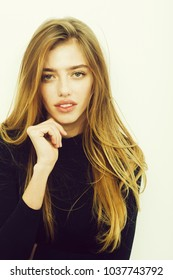 sexy pretty girl or beautiful woman with long, blond hair, hairstyle, in black sweater has young face isolated on white background