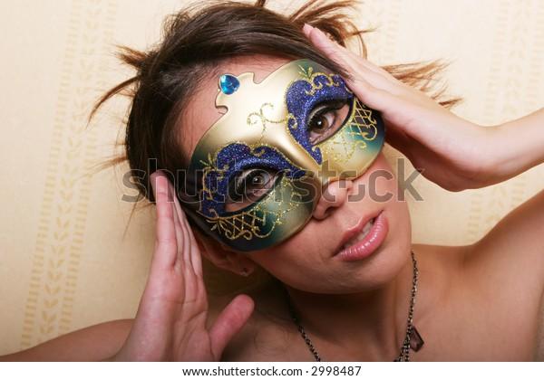 Sexy pretty woman in mask