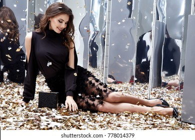 Sexy pretty woman sit floor with lot of golden sequins glamour fashion model bright makeup perfume wear black stylish dress celebration party holiday beauty salon Christmas Birthday girl Valentine's.