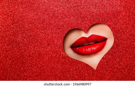 Sexy Red Lips Makeup Close up. Beauty Red Lipstick Make up look out Heart Hole Glitter Red Color Paper Background Copy Space. Cosmetic Salon Professional Advertising