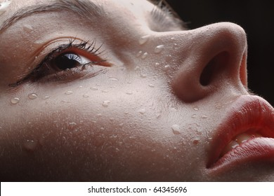 sexy red lips, slightly opened mouth, some water drops on wet face of young girl