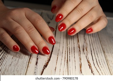 sexy red manicure long nails on the texture