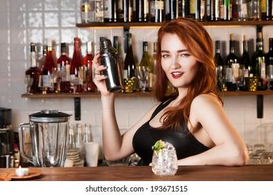 Sexy redhead bartender