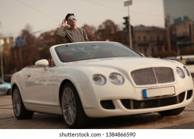 Sexy, rich, guy. Model. Man. Male. Bentley, Success, successful. supercar, car, super car. Attractive. Comfort. Lux, luxury, Vehicle, driver. Auto, automobile.  Happy dream. Young.