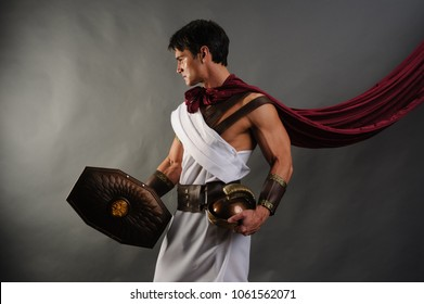 the sexy roman warrior is preparing for battle.