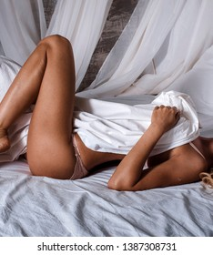 Sexy russian blonde girl professional photo shoot. Model in a small black lingerie and erotic underwear.