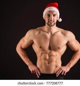 sexy santa claus on black background