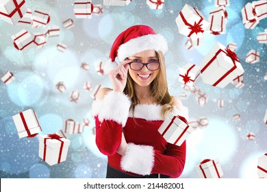 Sexy santa girl wearing spectacles against light glowing dots design pattern