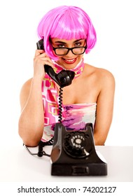 Sexy secretary by the phone wearing a pink wig � isolated
