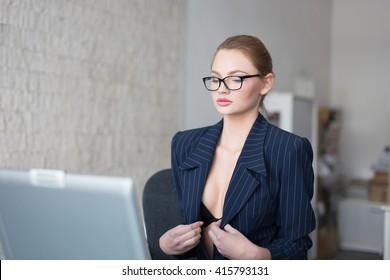 Sexy secretary in formal dress undressing in office, online flirt