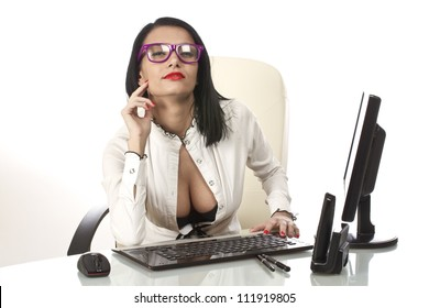 Sexy secretary at her office desk