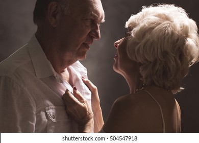 Sexy senior couple during foreplay before sex