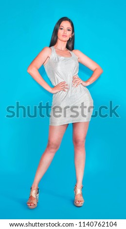 Sexy Sensual Confident Latina Woman With A Party Mini Skirt On A Blue Chroma Background